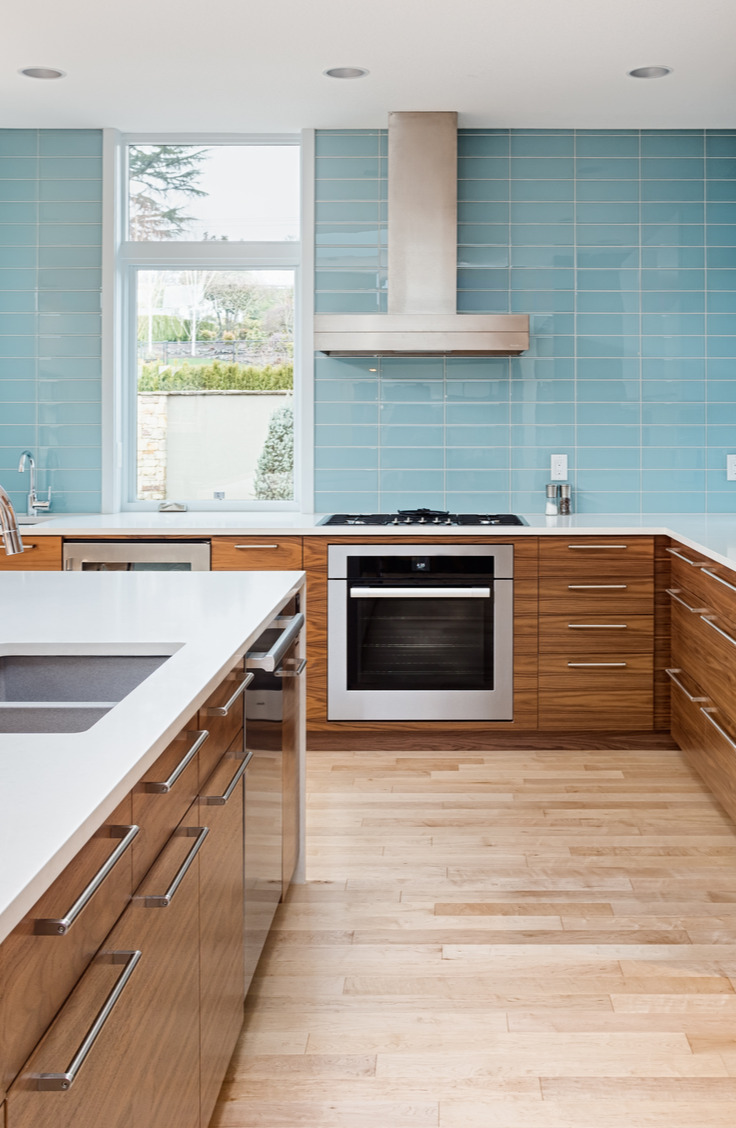 A great solution for a unique backsplash is to cover yours in tempered glass. Get inspired to take the plunge and make your home look a little cozier with a coastal backsplash kitchen.