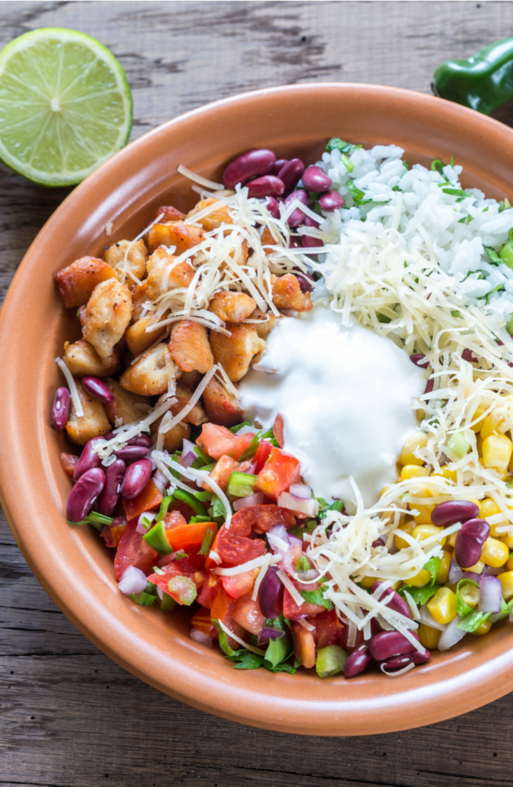 While vacationing, the last thing that you want to do is be a slave in the kitchen! Part of the fun of vacationing is to spend a lot of time eating, of course, but not a lot of time in the kitchen! Check out these easy vacation meals that don't take much time or effort. These burrito bowls are quick, easy, and delicious!